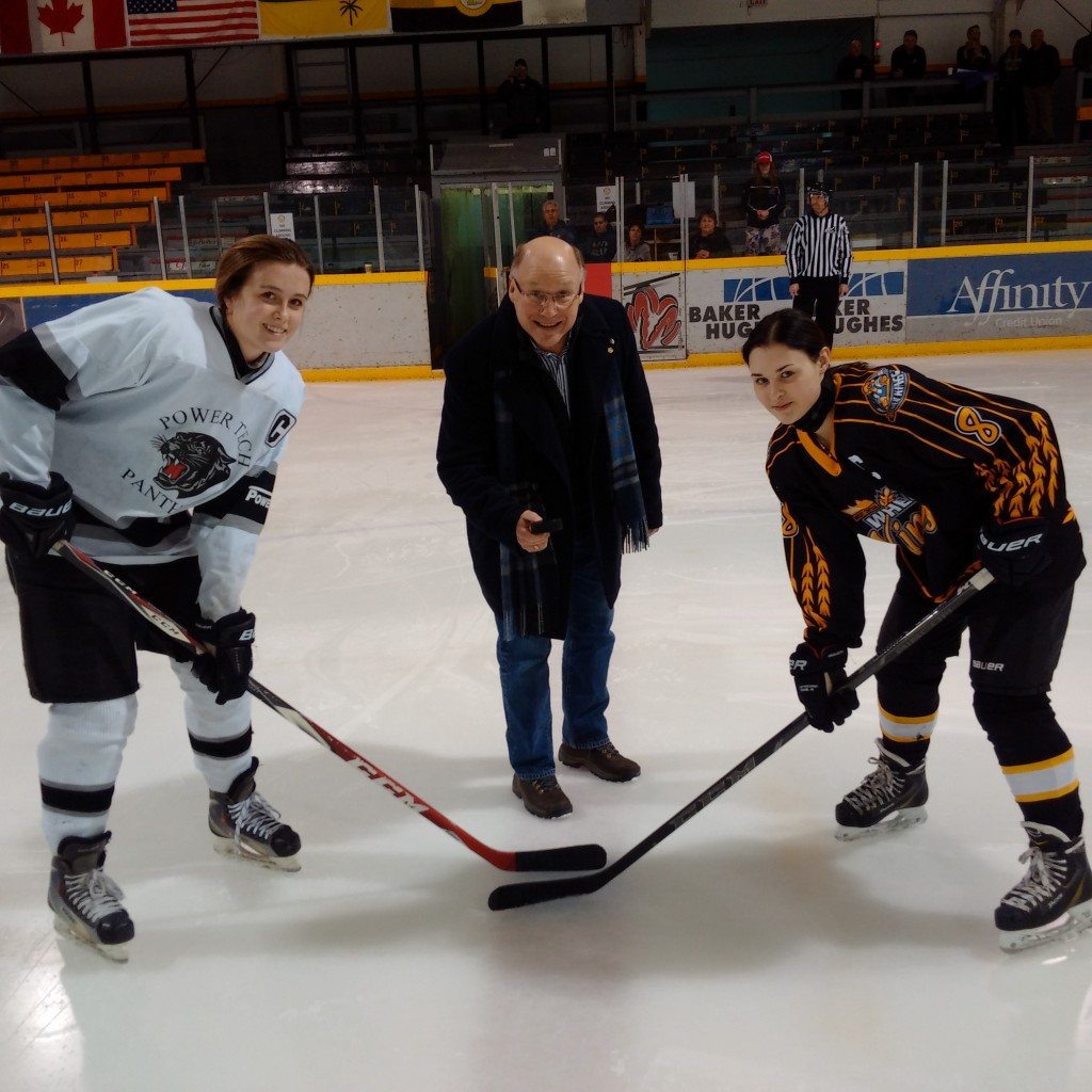 Puck dropping at the first game of the Midget AA provincial female final
