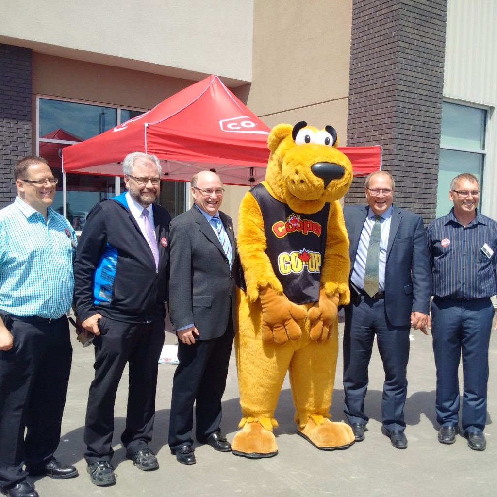 from left:‎ Oxbow Co-op grocery store manager Cam McNabb, Southern Plains Co-op board president Robert Grimsrud, yours truely, mascot Cooper, Federated Co-operatives Ltd Board President Clint 'Dusty' MacDonald, Southern Plains Co-op General Manager Brian Enns