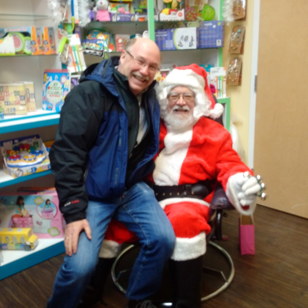 Sitting on Santa's knee asking for 'Coal power electricity and No Carbon Tax'
